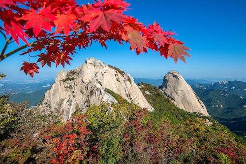 Baegundae peak and Bukhansan mountains in autumn